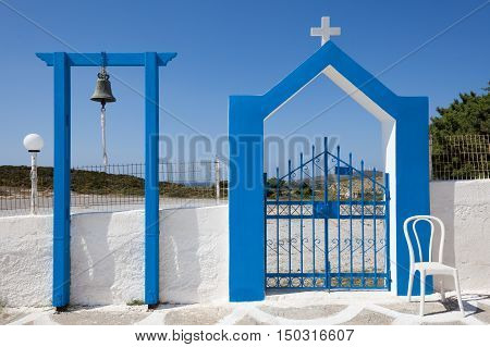 Bell and gate of church in Kos island Greece