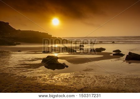 Beach and beautifull sunset reflection in the water