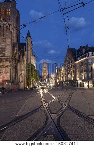 Ghent, Belgium, 27 august 2016: st niklaas church in belgian town of Gent with tram rails at night