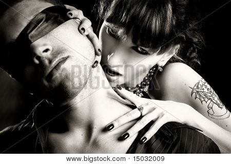 black and white photo of  vampire woman  bites a blind man