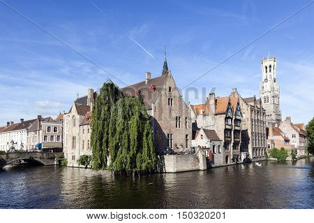 Maarssen, Netherlands, 30 september 2016: old houses along canal in centre of medieval Brugge in Belgium with blue sky in summer