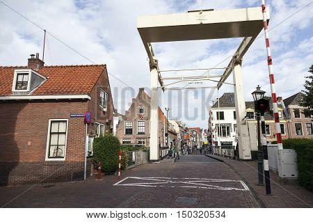 Maarssen, Netherlands, 30 september 2016: old wooden drawbridge and old houses in centre of Maarssen