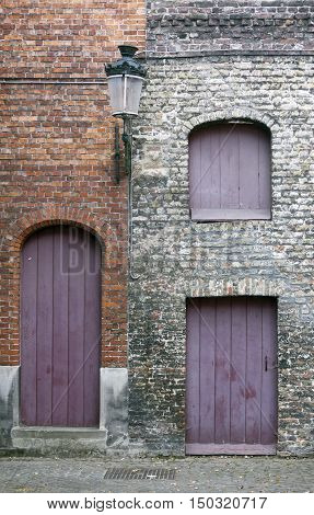 closed purple doors and shutters in the old town of Brugge in Flanders