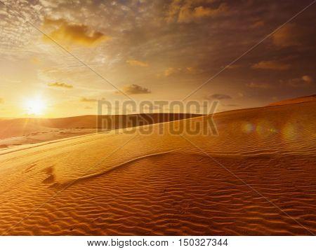 White sand dunes on sunrise, Mui Ne, Vietnam. With lens flare and light leak