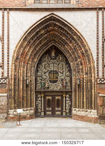 The ornate portal of Saint Nicholas?? church at Stralsund, Germany