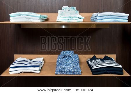wooden store shelf with color clothes