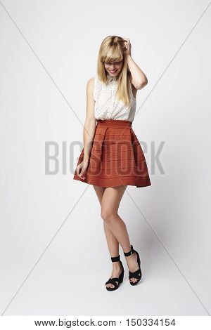 Posing beautiful woman in skirt -white studio
