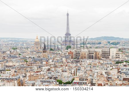 Paris city roofs skyline with Eiffel Tower from above, France