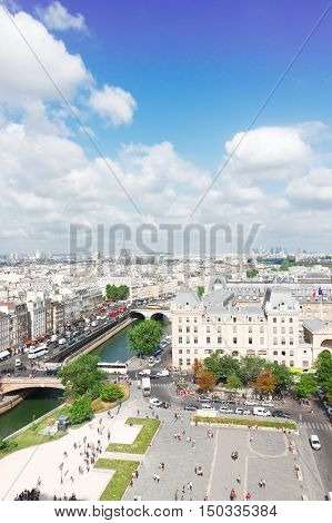 skyline of Paris city roofs and Seine river frome above at sunny summer day, France