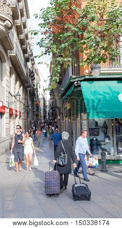 Barcelona - 10 October 2015: Many people and tourists walking on the street Boqueria October 10 2015 Barcelona Spain