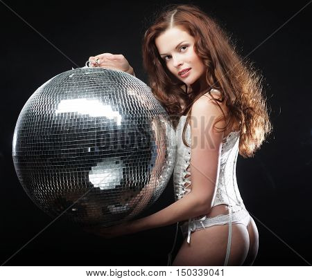 dancer redhair girl  with disco ball over dark background