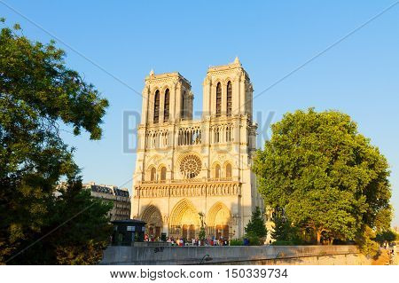 facade of famous Notre Dame cathedral at summer day, Paris, France