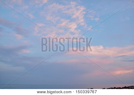 at sunset evening sky with pink clouds