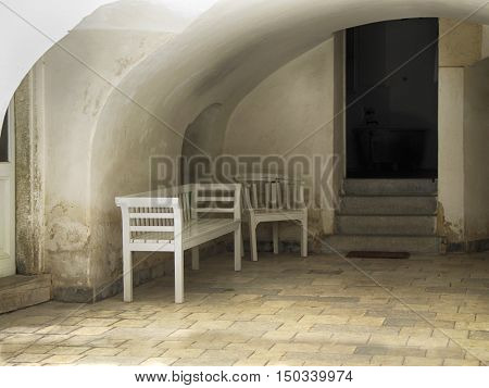 Old Wooden Bench and Seat on the Cobblestone