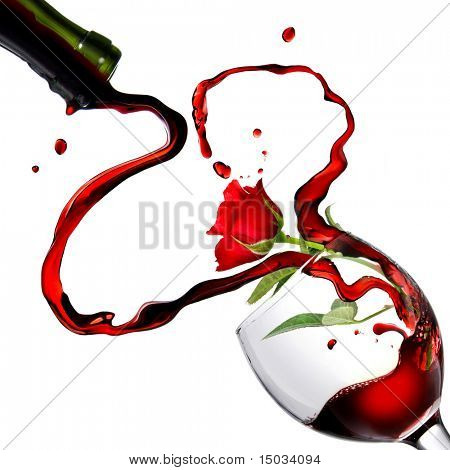 Heart from pouring red wine in goblet with red rose isolated on white