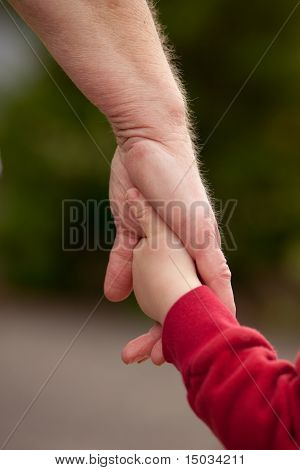 Mature Woman Holding Hands With Young Child
