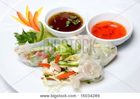 chinese rolls with vegetables on the plate