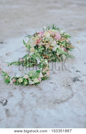 at sunset on the beach with salt crystals delicate bouquet of flowers and a wreath