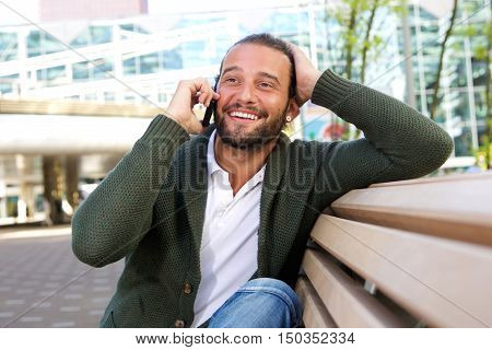 Surprised Man With Hand To Head Talking On Phone