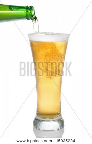 Beer pouring from bottle into glass isolated on white