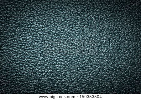 Deep green leather texture or leather background for design with copy space for text or image. Dark edged.