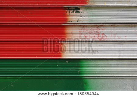 Red and green lines on the metal.