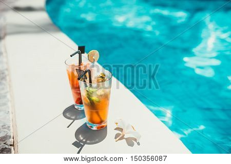 Close-up Of Two Alcoholic Drinks, Ice And Gin And Tonic Lemonade And Mojito With Lime Served Cold At