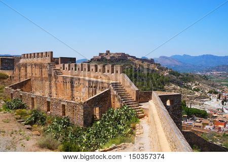 a view of the Moorish and Ancient Roman remains of the Citadel of Sagunto, Spain, in the top of a hill