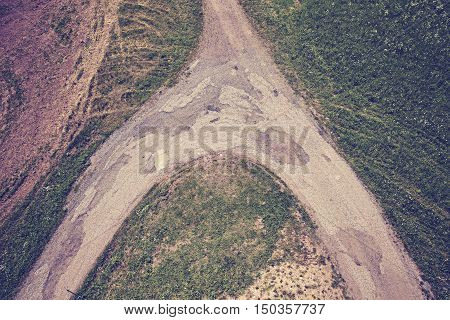 Vintage Toned Dirt Road Crossroads Seen From Above.