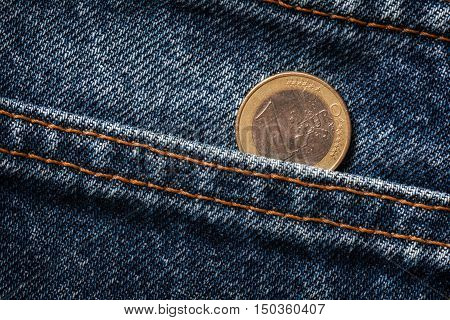 European coin in jeans pocket. One euro