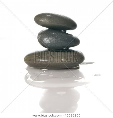 Spa stones with reflection isolated on white