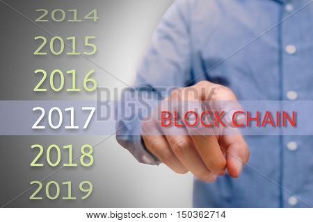 Man hand pointing block chain text Body man businessman planing for 2017. Business new year plans and targets concept.