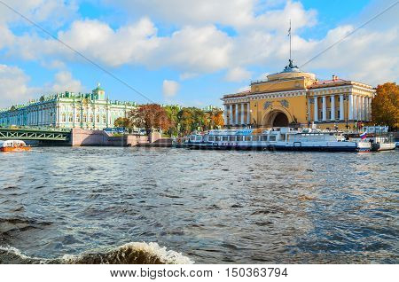 ST PETERSBURG RUSSIA-OCTOBER 3 2016. Admiralty arch and Winter Palace on the embankment of Neva river in St PetersburgRussia. Architecture landmarks of St Petersburg in autumn sunny day