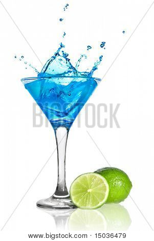 Blue curacao cocktail with splash and green lime isolated on white