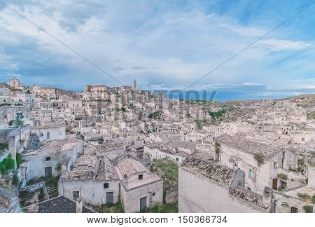 Panoramic View Of Stones (sassi Di Matera) And Church Of Matera Under Blue