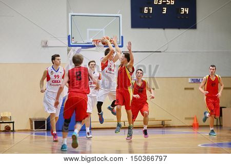 MOSCOW, RUSSIA - DECEMBER 12, 2015: Fight for the ball during basketball match at the indoor stadium betwen CSKA and Labor Reserves teams.