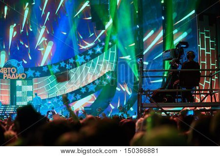 MOSCOW, RUSSIA - NOV 28, 2015: Spectators enjoy Disco 80 concert show by Autoradio in Olimpiyskiy sports complex. The festival is held annually since 2002.