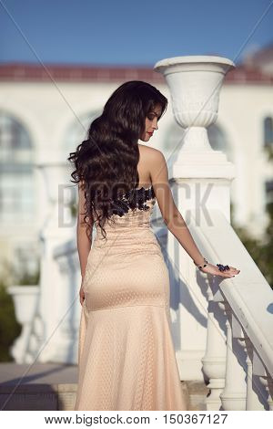 Beautiful Fashion Brunette Woman In Elegant Dress With Long Wavy Hair Style Come Upstairs, Outdoor S