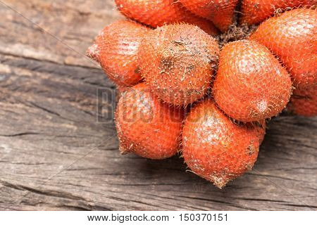 Salak Sala Palm Closeup Asian fruit (Salacca zalacca) on the wooden floor background