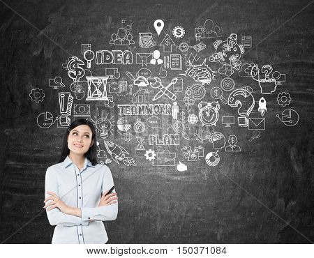 Girl With Black Hair Near Blackboard With Startup Icons