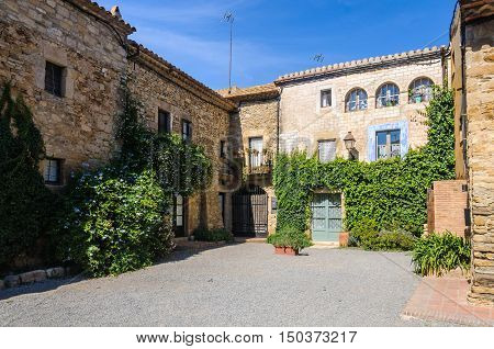 PERATALLADA, SPAIN - SEPTEMBER 26, 2015: Charming small square in Peratallada village in Catalonia Spain