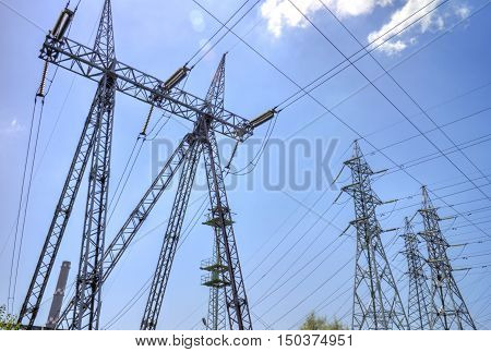 High voltage electrical overhead lines on blue sky