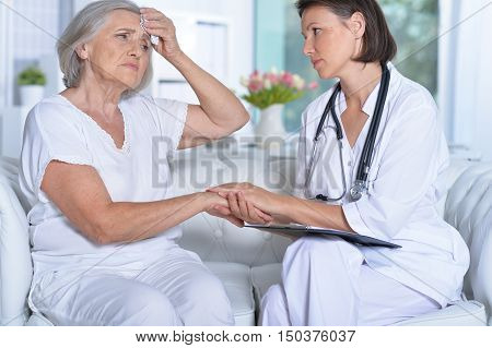 Portrait of a female doctor and her senior patient