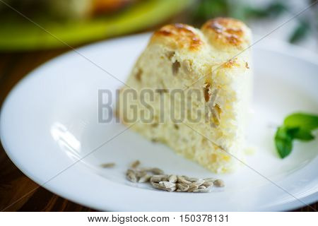 curd rice casserole stuffed sunflower seeds on a plate