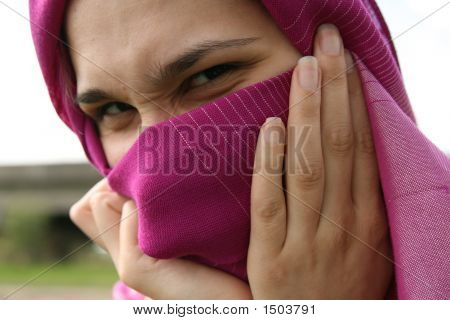 Muslim Woman Hiding Her Face