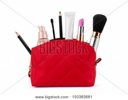 Red bag for cosmetics with a make up accessories on a white background.