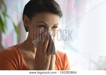 Portrait of  young woman feels sickness at home