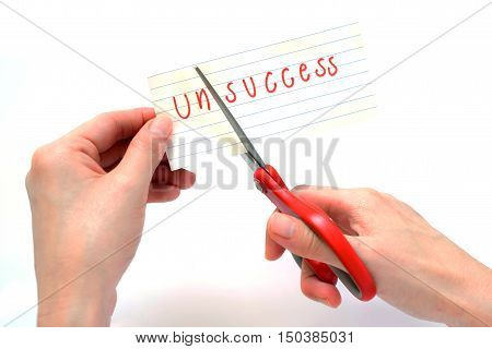 Female using scissors to remove the word unsuccess to read success concept for self belief positive attitude and motivation
