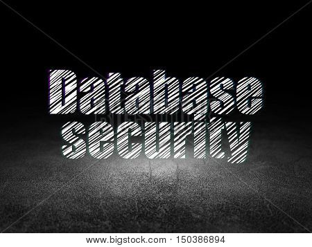 Database concept: Glowing text Database Security in grunge dark room with Dirty Floor, black background
