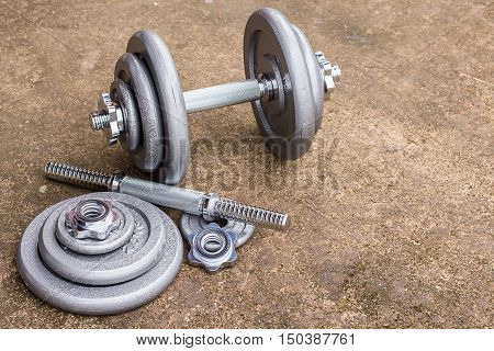 Close up dumbbells on cement floor. fitness concept